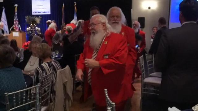 A bunch of Santa Clauses celebrate the end of their time at the St Nicholas Institute during the organization's awards gala in Livonia. No cups of Christmas cheer were needed. These guys have the spirit.