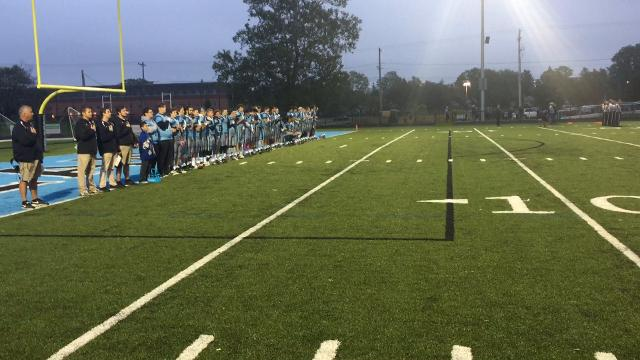 As expected, four Lansing Catholic football players knelt Friday night during the national anthem. Seniors Michael Lynn III, Roje Williams, Matthew Abdullah and junior Kabbash Richards took a knee next to each other as the rest of the team stood.