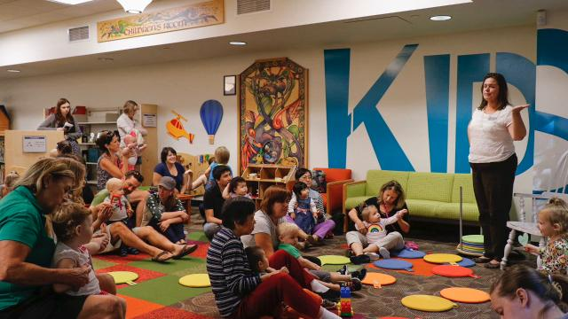 Youngsters attend 'Babytime' at the East Lansing Public Library where a storyteller reads them a book in honor of Indigenous People's Day.