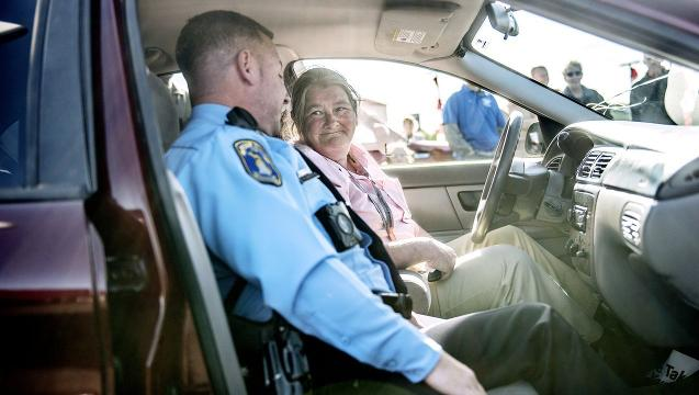 Lansing police officer surprises woman with new used car