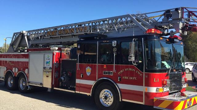 Winners of an essay contest at Michigamme Elementary School get a ride on a Port Huron Township firetruck.