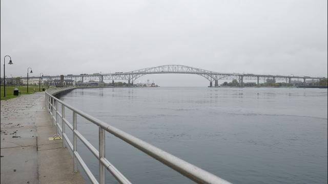 Rain, mist and a freighter pass by the Blue Water Bridge the morning of Nov. 2.