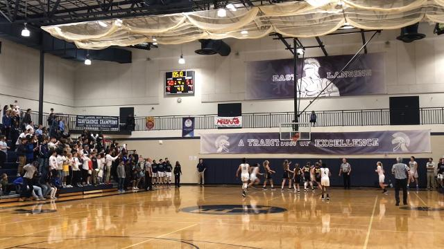 See highlights from East Lansing's 52-51 win over DeWitt on Dec. 5, 2017, and hear comments from Aazh Nye. Brian Calloway | LSJ
