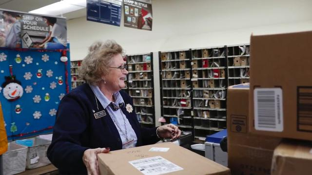 Postal worker Marion Smith loves going to work.  She drives 90 miles round-trip five days a week between her home in Corunna and the Haslett Post Office.  We visit her to find out why.