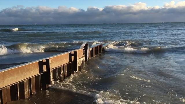 Lake Huron waves roll onto shore
