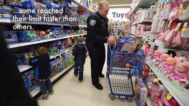 The event pairs in-need children with a police officer, a shopping cart and a Meijer gift card.