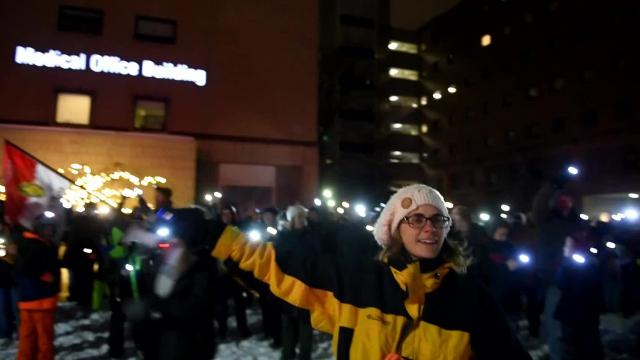 Close to 200 people have been showing up each night to Royal Oak Beaumont Hospital to wish pediatric patients a good night by waving with flashlights to the kids as they wave back. The event continues nightly until Dec. 31.