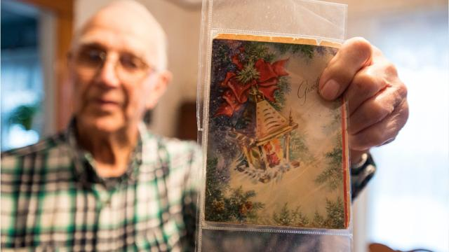 Art Hebel and his friend have been passing back and forth the same Christmas card since 1948.