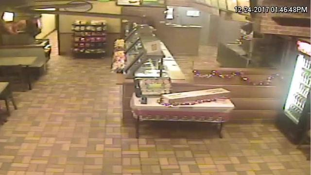 Surveillance footage of an armed suspect entering a Pontiac Subway restaurant demanding the cash in the register. The suspect is described as a black male, wearing all black clothing and a mask. He left with about $100, according to a news release from the Oakland County Sheriff's Office.