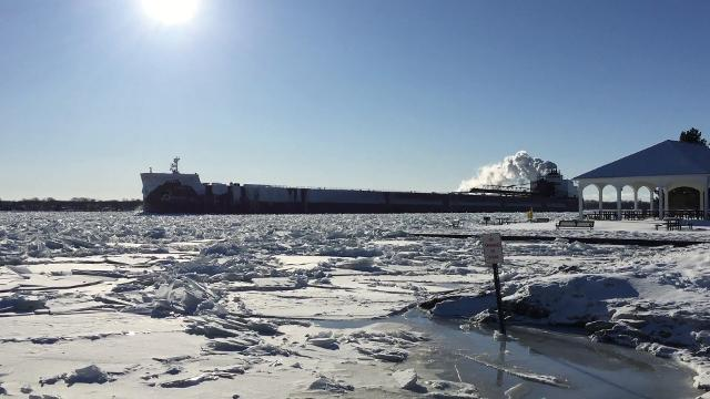The Erie Trader and the James R. Barker pass in an ice-choked St. Clair River near Marine City.