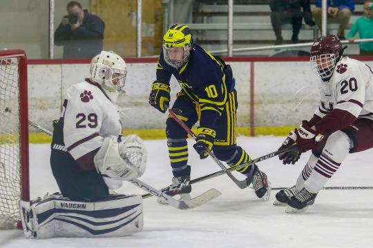 Jake Behnke scored both Hartland goals, including the winner in overtime, in a 2-1 victory over U-D Jesuit. Jesuit tied the game with 0.1 seconds left in the third  period.