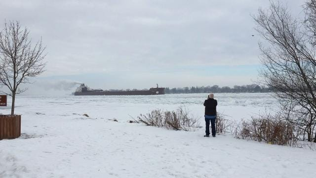 People are flocking to parks and other pubic access areas to watch freighters coping with ice.