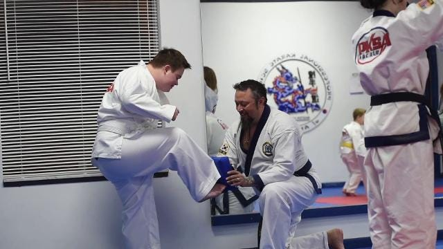 Anna Dearhamer, 14, and Cole DiNardo, 17, attend classes at PKSA Karate as part of a University of Michigan study. The study focuses on the effects of martial arts on kids with Down syndrome.
