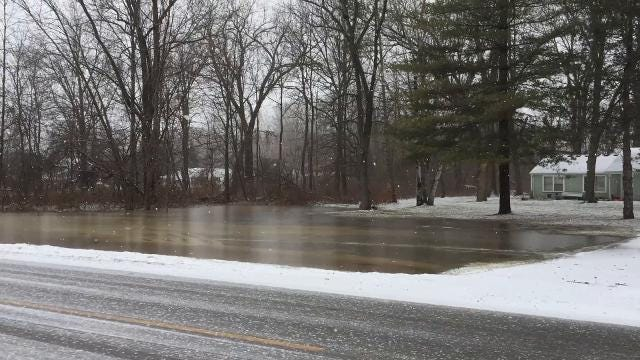 Water floods yards along Pointe Drive