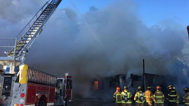 Firefighters from several departments battle a fire Saturday in Berville