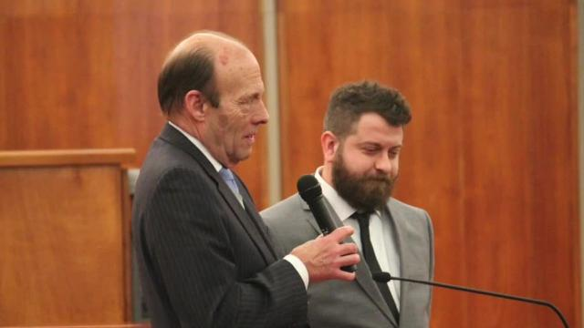 Justin Hirt speaks at the Oakland County Adult Treatment Court graduation Wednesday afternoon in Pontiac.