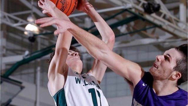 Fowlerville's QB Geoffrey Knaggs has added standout basketball player to his resume