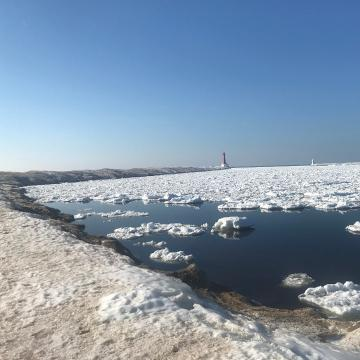 Lake Michigan is covered in clumps of snow and ice, making for a cool effect when it moves. Check it out.