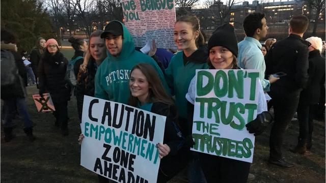 People gathered at the rock on Michigan State University's campus Friday night in support of the sexual assault survivors who spoke out in court against former doctor Larry Nassar.