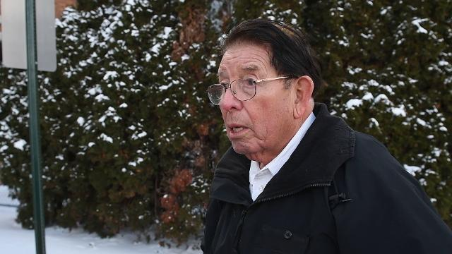 Salvador Alvarado, 84, recounts his fall on Wednesday, Feb. 7, 2018, at the site where he slipped into a drain at the exit of the Sparrow Hospital Professional Building parking garage last week in Lansing.