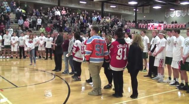 Students Darian Locklear and Julianna Ward-Brown were remembered at a rivalry basketball game between Brighton and Howell.