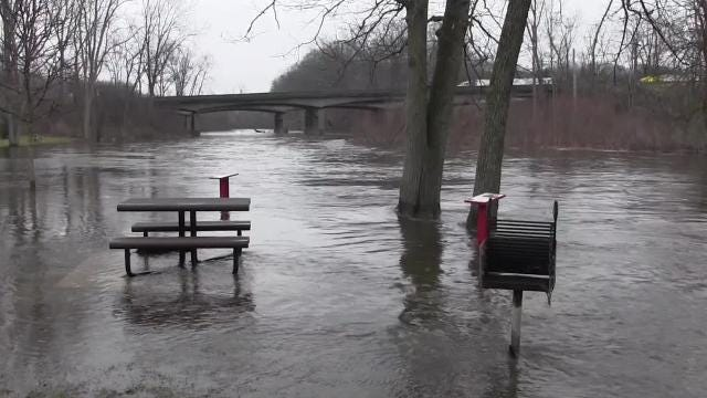 The parking lot is flooded at Historic Bridge Park Friday, Feb. 23.