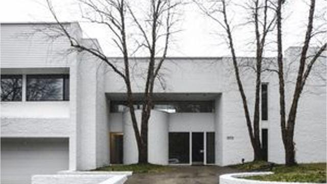 This modern white two-story in White Hills Estates in East Lansing was designed by architect Irving Tobocman, and is listed for sale at $695,000.
