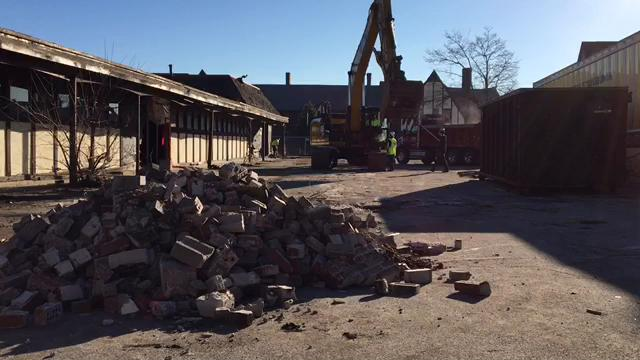 Crews began to raze the building across from the St. Clair Inn Monday morning, Feb. 26, to make room for a new, mixed-use structure, which will house retail and a fitness center and spa.
