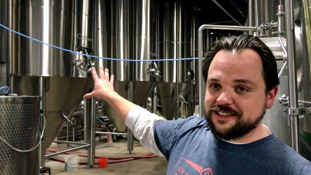Old Nation Brewing Company's Travis Fritts talks about the popular M-43 beer in the fermentation area of the brewery on Wednesday, Feb. 28, 2018, in Williamston.