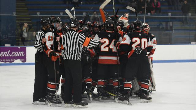 With a two-man advantage in the second overtime period, Brother Rice forward Luke Kafati (9), buries the game winning goal after teammate Garrett Moore slid the puck through the crease to a wide open Kafati.