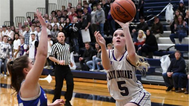 No. 3-ranked Adrian Lenawee Christian defeats honorable mention Athens, 62-31.