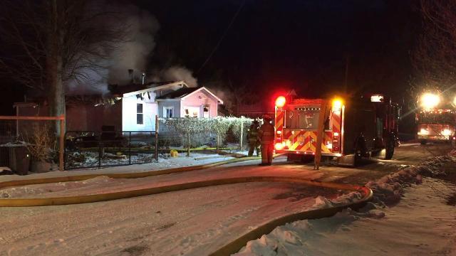 Firefighters battle fire on 33rd Street in Port Huron Township