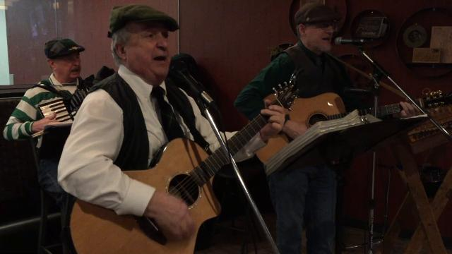 """The group Celtic Cross performs the traditional folk song """"The Black Velvet Band"""" at the United Way of St. Clair County's annual St. Patrick's Day Breakfast."""