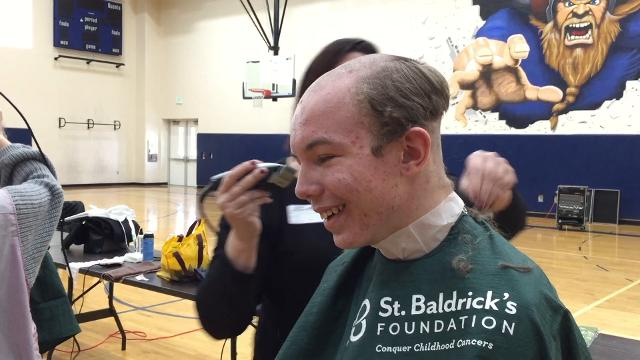 Michael Pitzo, an eighth-grader at Marysville Middle  School, was among about 25 students who had their heads shaved to raise money for the St. Baldrick's Foundation that raises money for pediatric cancer research.