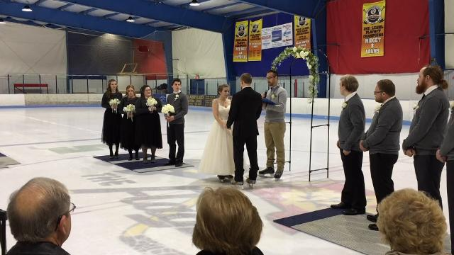 The bride and groom were on skates.