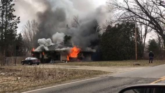 A house on N Drive North, also known as Gorsline Road, in Battle Creek is engulfed in flames Saturday, March 24, 2018.