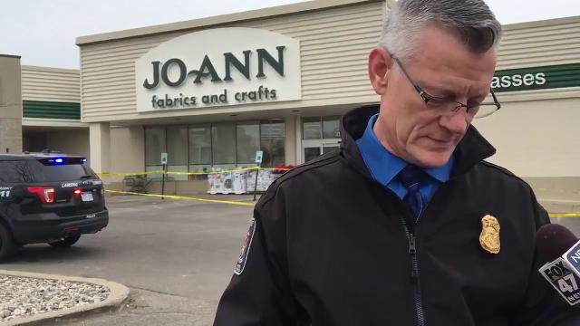 Lansing Township Police Chief Adam Kline speaks about a murder-suicide