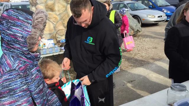 Kids scramble for Easter eggs at Blue Water River Walk