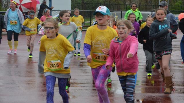 500 girls complete three-month Girls on the Run program with celebratory 5K at Harper Creek High School.