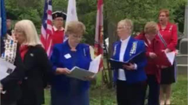 The Michigan Society Sons of the American Revolution color guard perform a sword salute to two Revolutionary War soldiers buried in the New Hudson Cemetery.