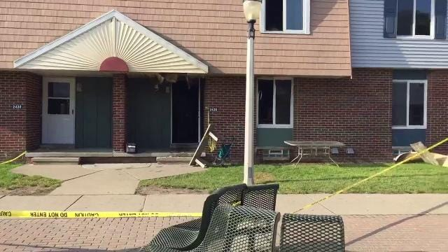 Lansing Fire Department officials confirm a 30-year-old woman and her 5-year-old son were killed early this morning in a house fire at the LaRoy Froh housing complex in south Lansing.