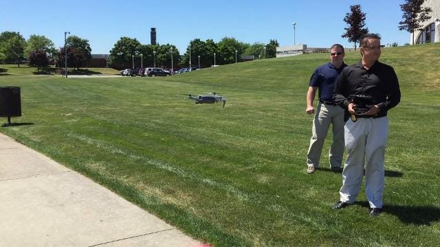 Lieutenants Joel Wood and Brian Georgia demonstrate one of the Port Huron Police Department's two drones