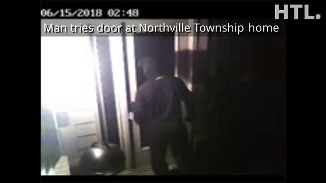 Home security video captured this shot of a masked man trying a door at a house in Northville Township early on June 15. Later, three completed home invasions in the township were reported.