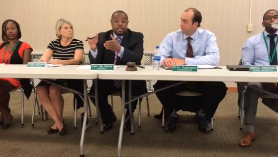Tony Baltimore, chair of the Lansing Housing Commission board, responded to residents and concerned citizens during a board meeting on Wednesday, June 28, 2018.