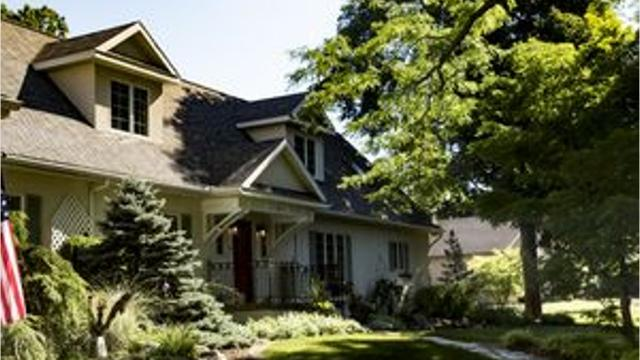 The nearly 6,000-square-foot home sits along 150 feet of the Grand River.