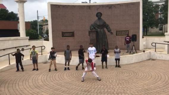 A group of Camp I Can kids dance in front of the Sojourner Truth Monument in Battle Creek on Friday to celebrate who they are and what they can become.