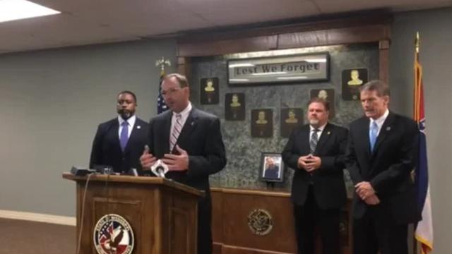 MBN Director John Dowdy, Deputy Director Steven Maxwell, and Major Mike Aldridge join Department of Public Safety Commissioner Marshall Fisher in a press conference about further health care provider arrests.