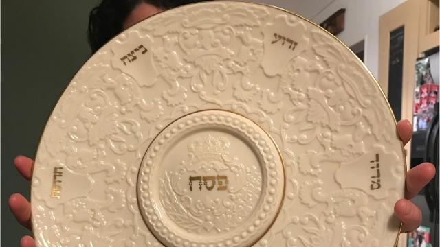Rachel Jarman Myers of Jackson explains the traditional Passover Seder plate as used at the Jewish holiday dinner.