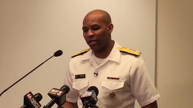 U.S. Surgeon General Jerome Adams says he's no hero for aiding a fellow flight passenger in a medical emergency, but he says any American can be a hero by having naloxone to counter opioid overdoses.