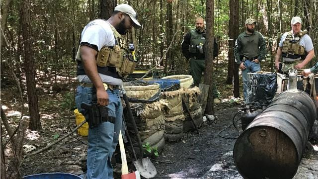 State agents raided a moonshine operation near the Sand Hill community on Friday, May 18, 2018.